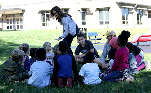 Elementary age kids play a tag game