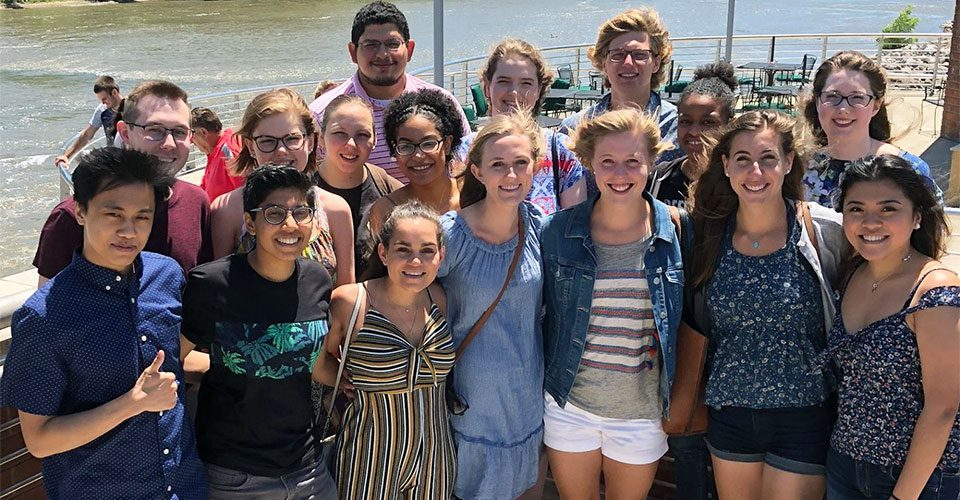 Students at the Iowa Summer Institute in Biostatistics pose in front of the Iowa River.