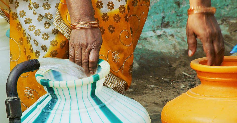 Woman filling water jugs