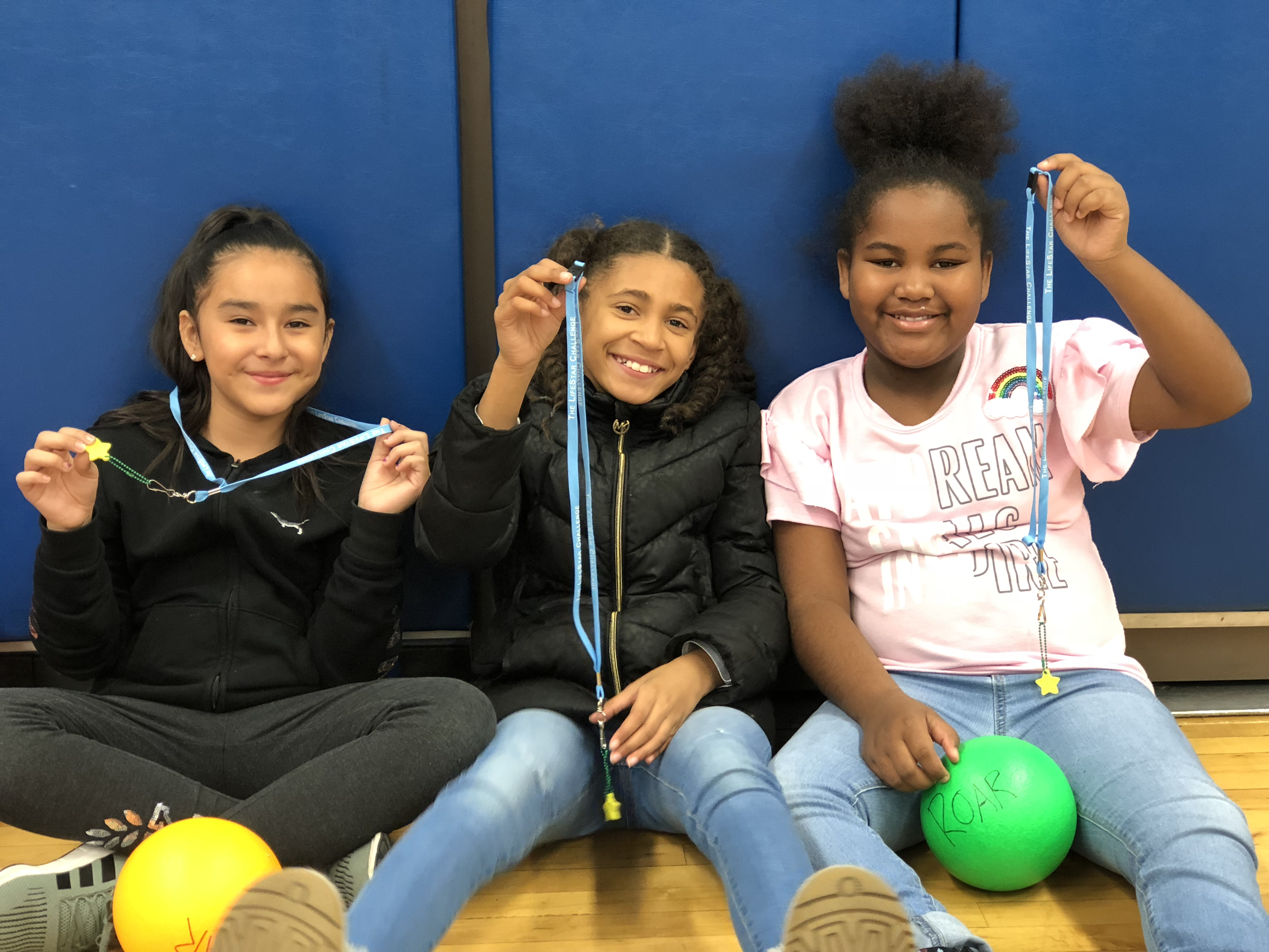 Students show their Healthy LifeStars necklaces