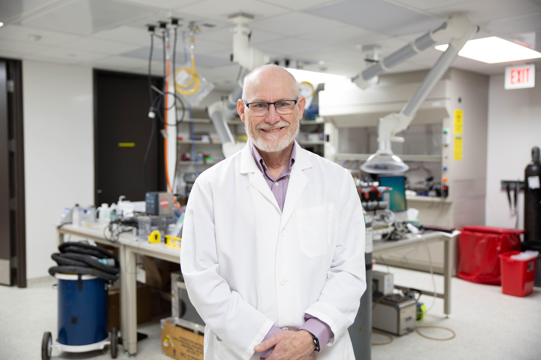 Portrait of Professor Peter Thorne in his lab