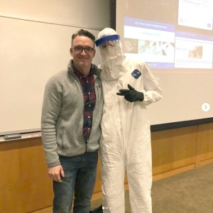 Matt Nonnenmann and a student demonstrate a hazmat suit