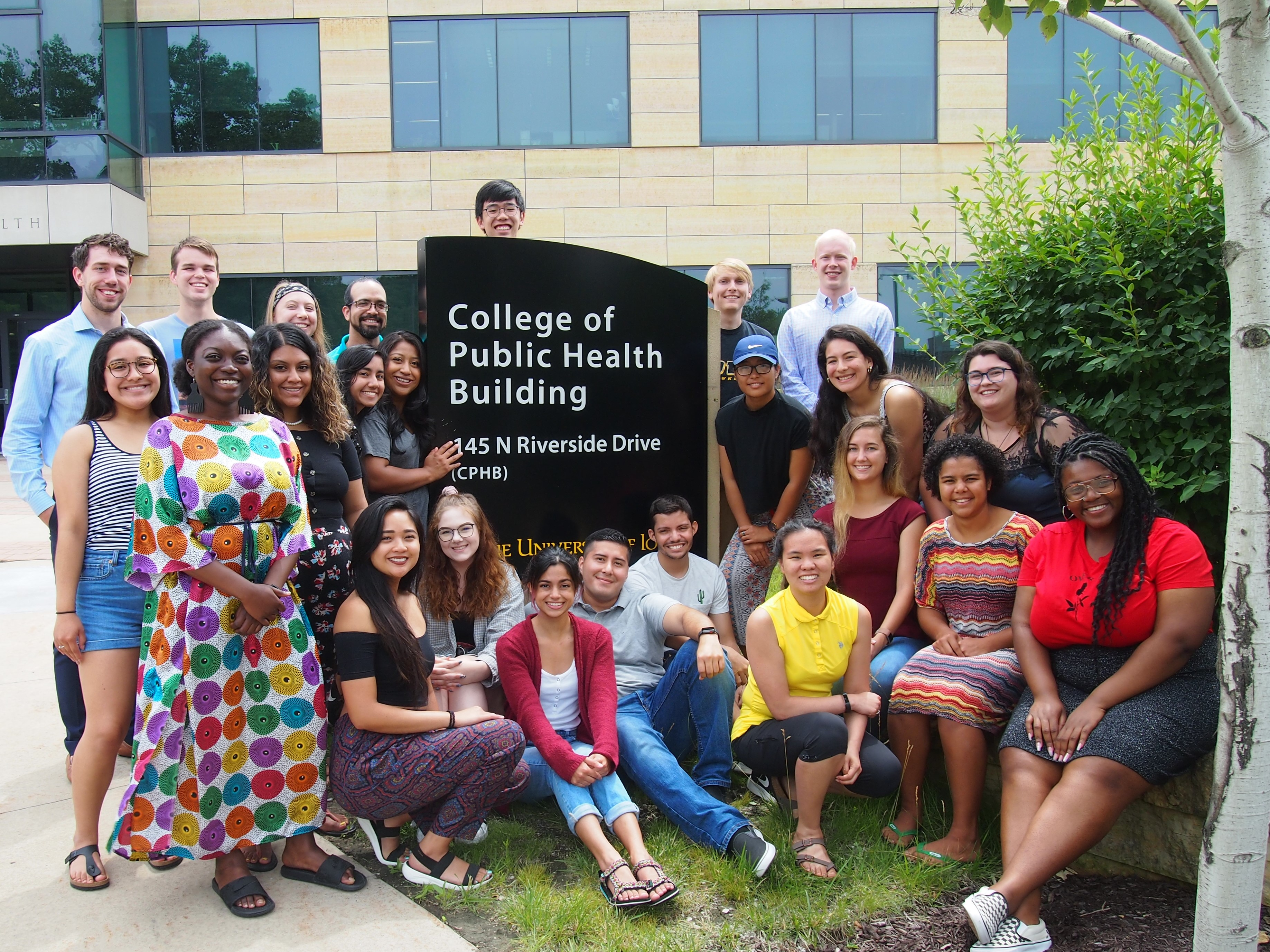 ISIB students pose in front of the College of Public Health Building