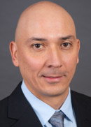 A portrait of Carlos Pelaez of the Department of Health Management and Policy at the University of Iowa College of Public Health.