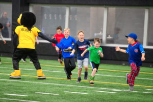 Healthy LifeStars kids playing with Herky the Hawk mascot