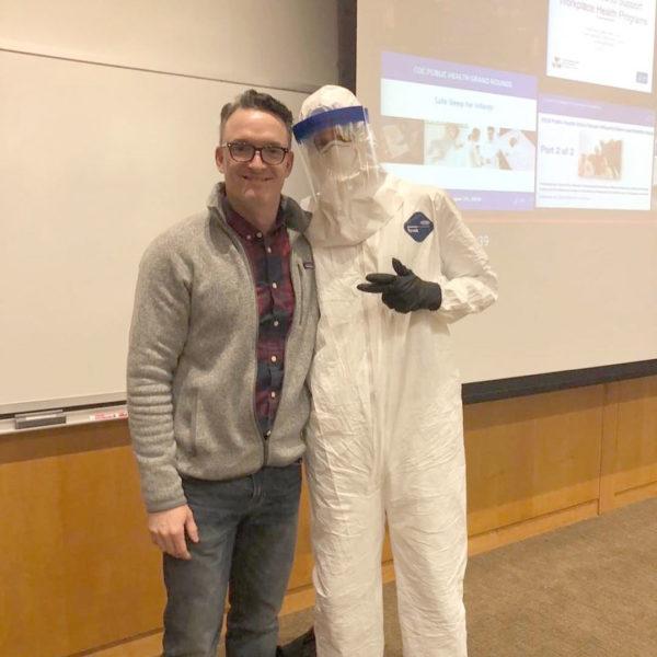 CPH Prof. Matt Nonnenmann poses with a student dressed in a hazmat suit.