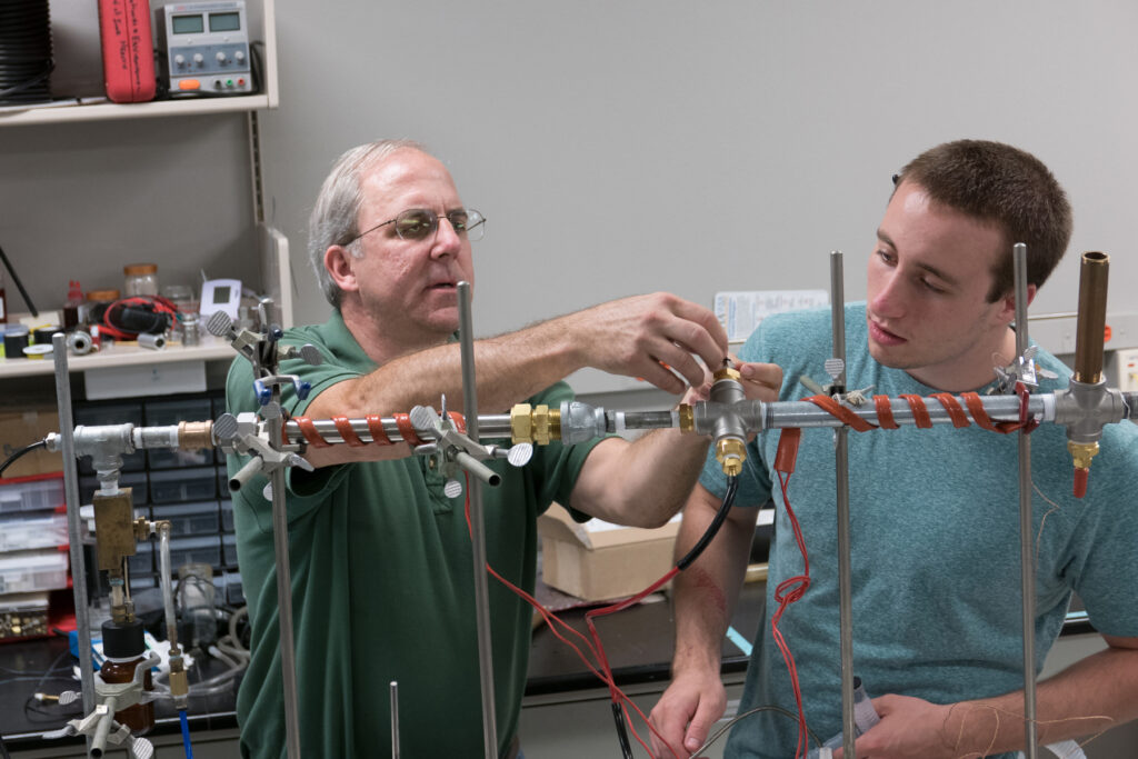 Prof. Patrick O'Shaughnessy assists a student in the lab