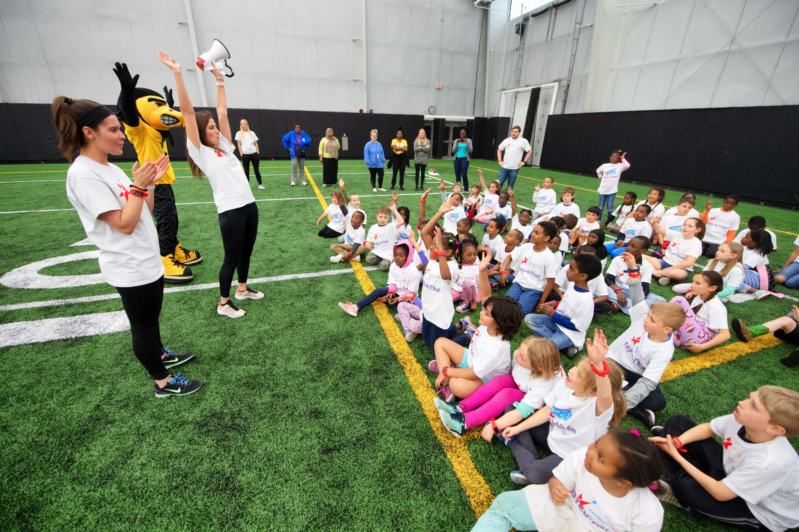 Students, Herky the Hawk, and coaches participate in a Healthy LifeStars event