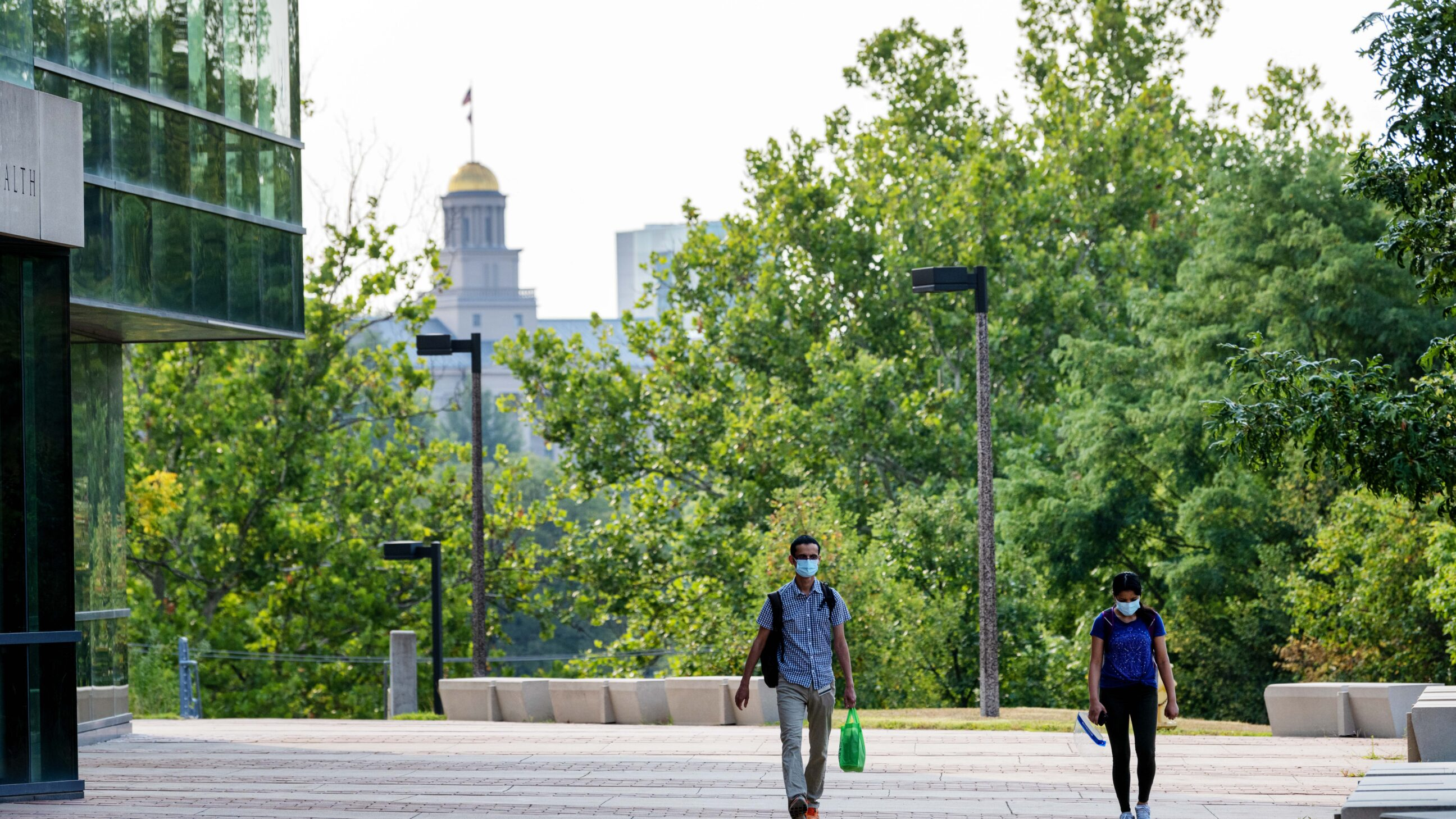 Students walking past the College of Public Health Building on their way to class.