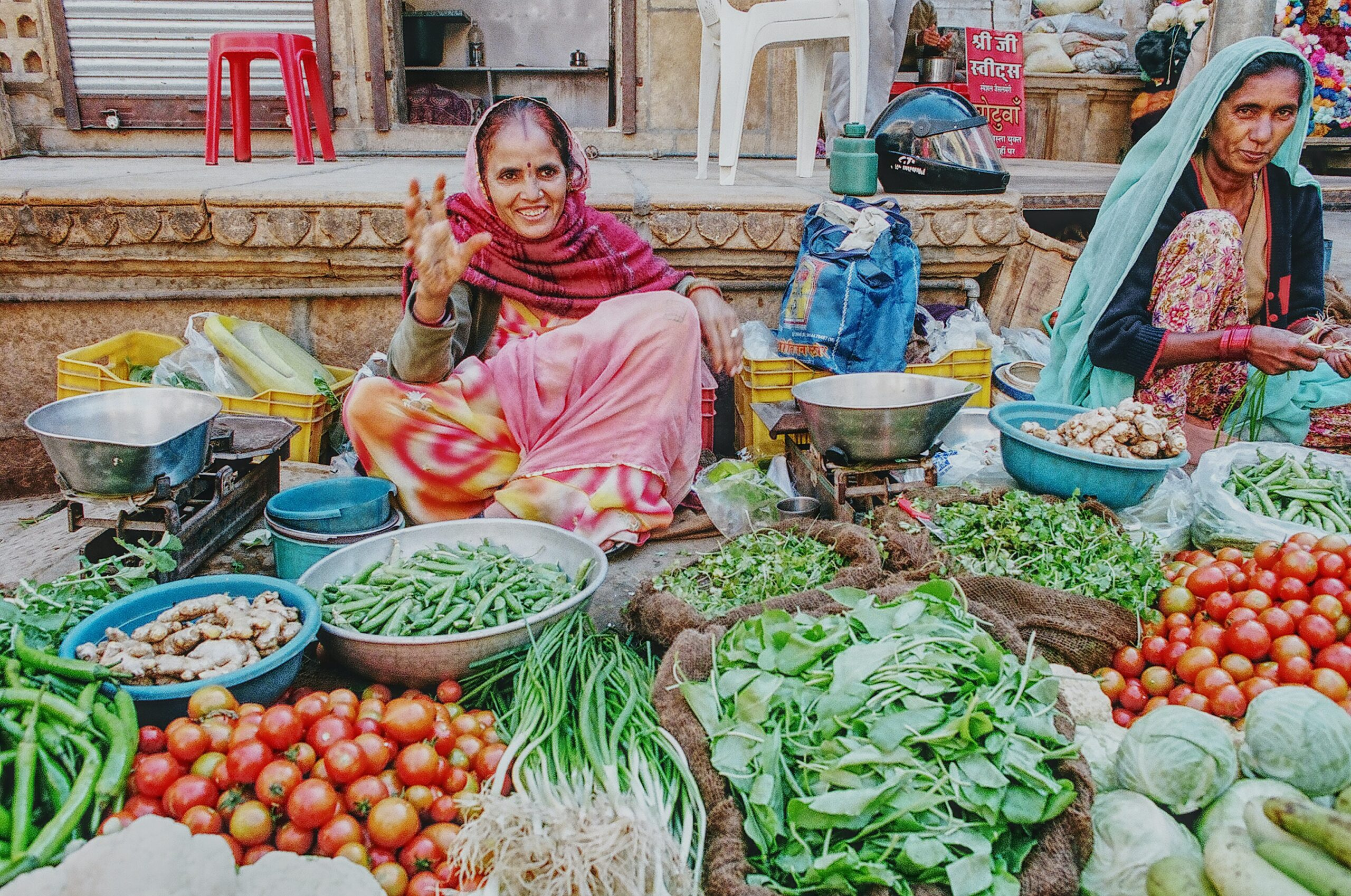Indian women selling produce at open-air market
