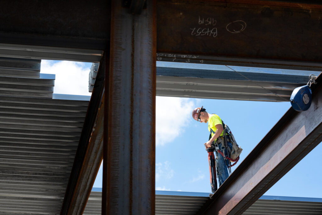 A construction worker working on the roof of the new UI Art Museum
