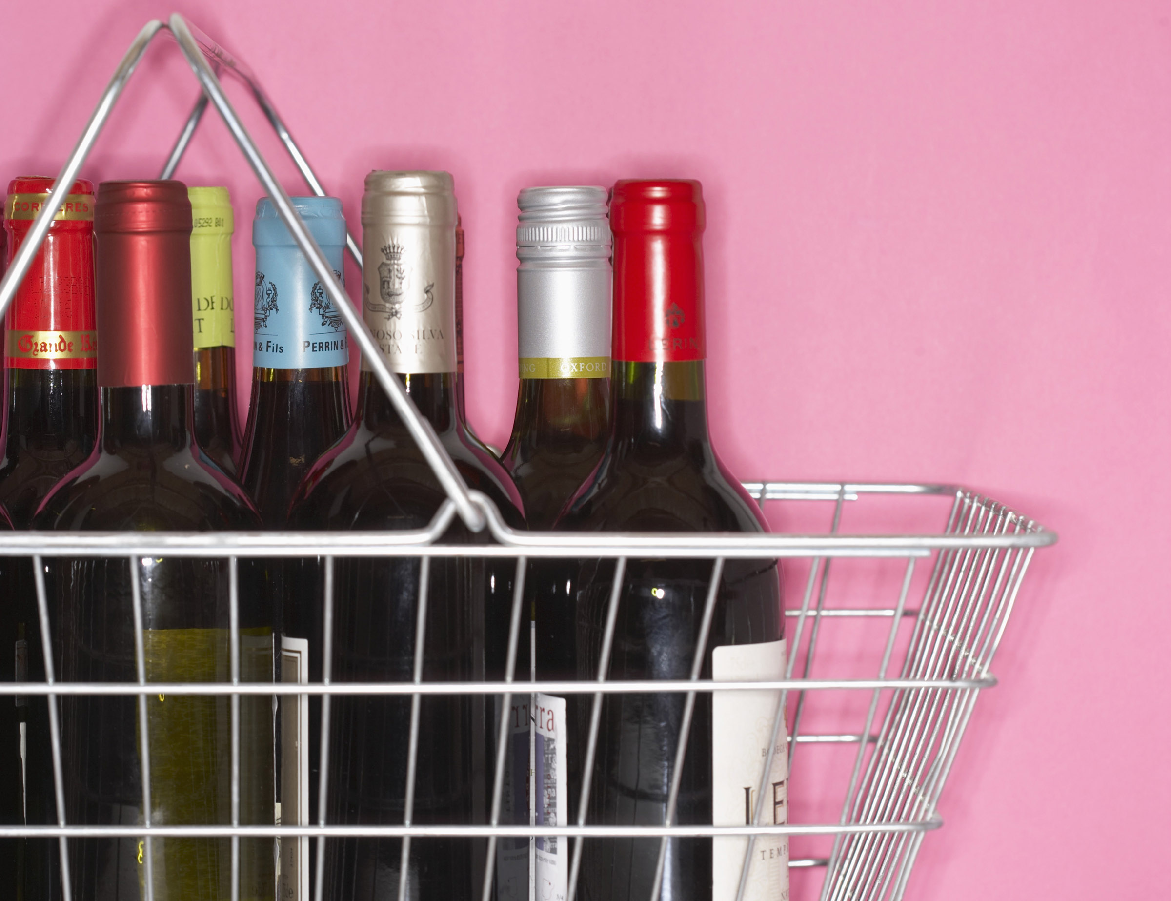 A shopping basket filled with bottles of wine