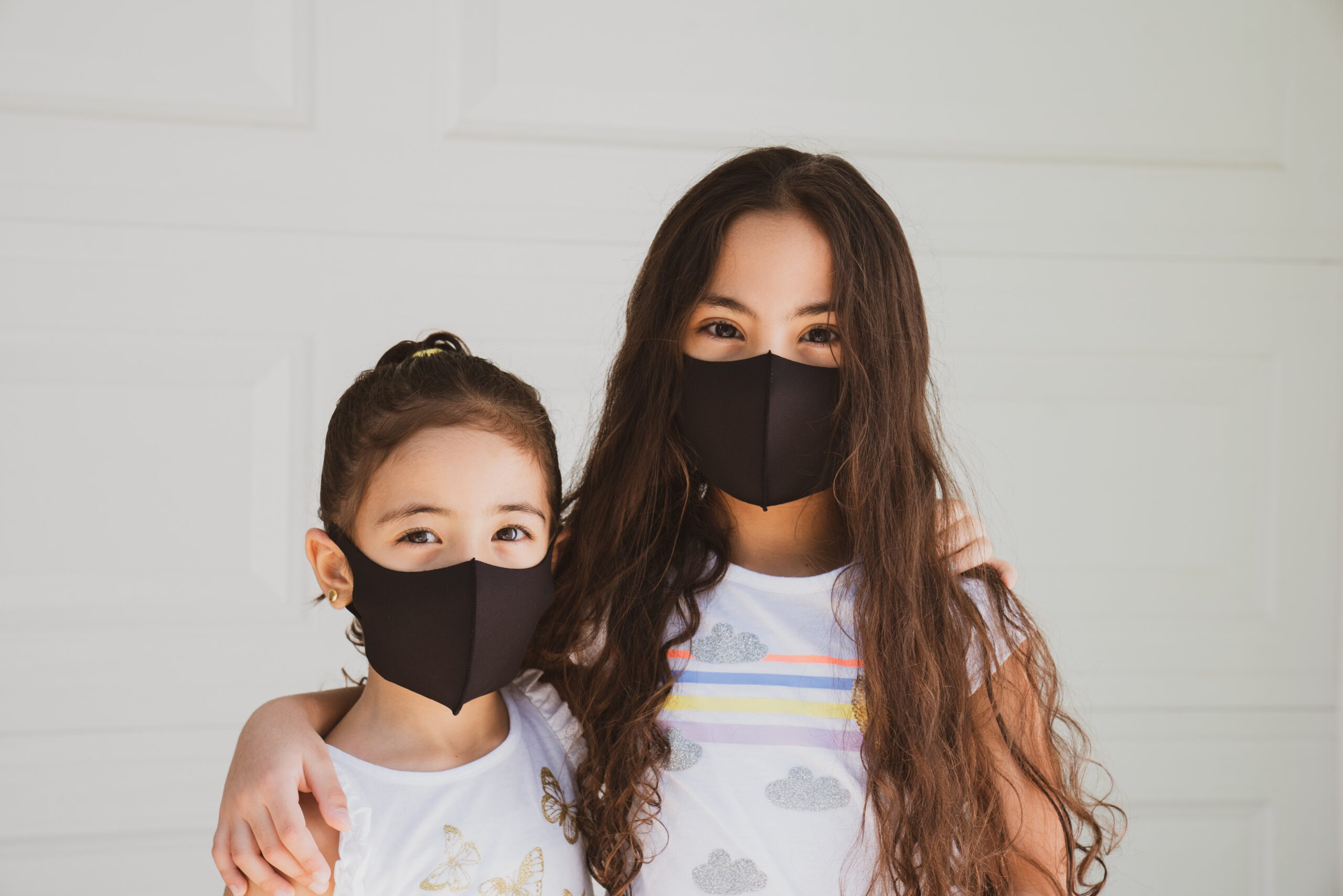 Parent and child with masks