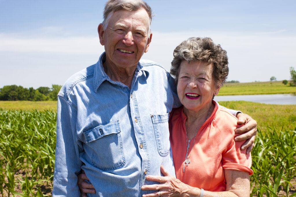 older adult farm couple outdoors